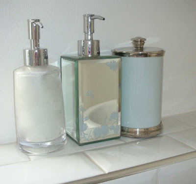 Bathroom dispensers: clear acrylic from John Lewis, mirrored soap dispenser from Marks and Spencer, enamelled canister from Restoration Hardware