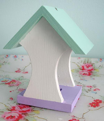 Painted wooden bird feeder