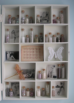Open curio cabinet in the craft room