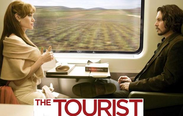 Angelina Jolie & Johnny Depp's odd, giant faces on 'The Tourist' poster