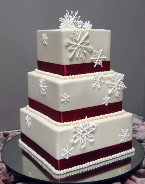 This wedding cake is decorated with sugar snow flakes and beautiful