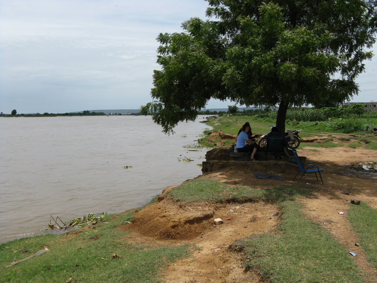 Stacy with a Fulani man making tea by the river