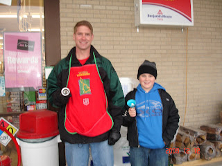Rep. Kraus with son Tannor serving as Salvation Army bell ringers