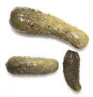 Photo of three pickles.