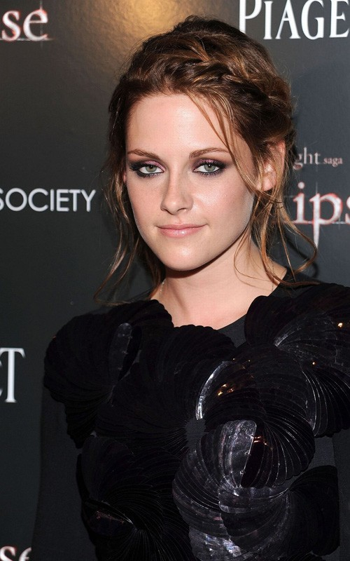 Kristen Stewart shows she can smile at Rome premiere of 'Twilight Saga: