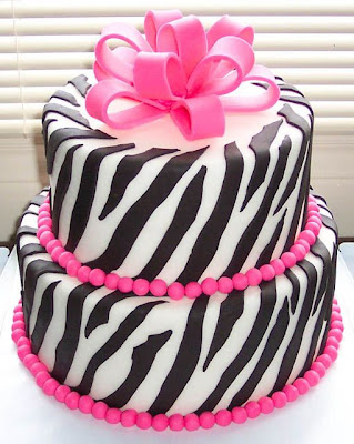 pink zebra wedding cake with ribbon