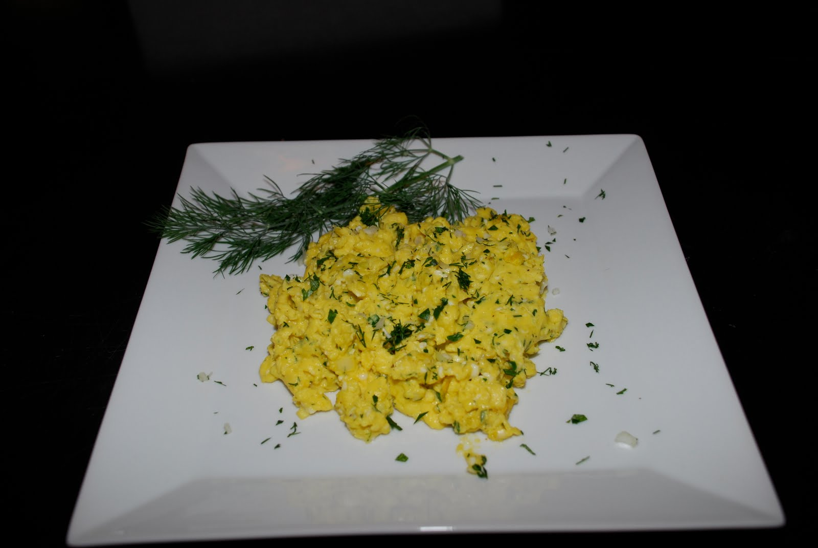 Tomatoes on the Vine: Slow-Cooked Scrambled Eggs with Fresh Herbs