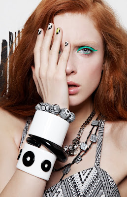graphic black and white accessories, manicure, neon green eyeliner