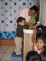 Mateo washing his hands again