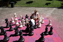 Mateo playing with a large chess set