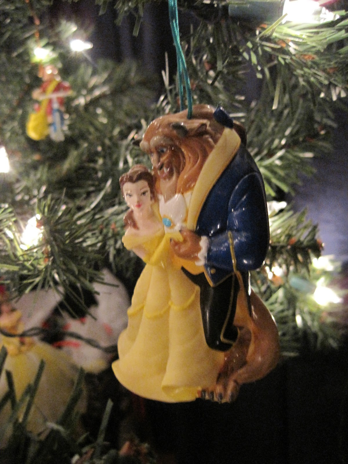 heres the last onemy vinyl disneyenesco belle and beast its another light up ornament belle and the beast are hollow so you can stick an ornament - Disney Beauty And The Beast Christmas Decorations