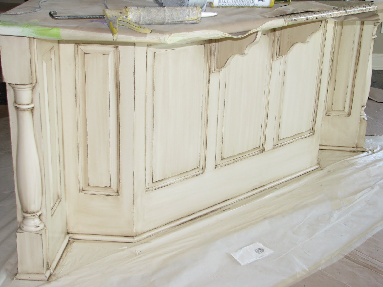 What 39 s not to love about a distressed cream island - Cream distressed kitchen cabinets ...