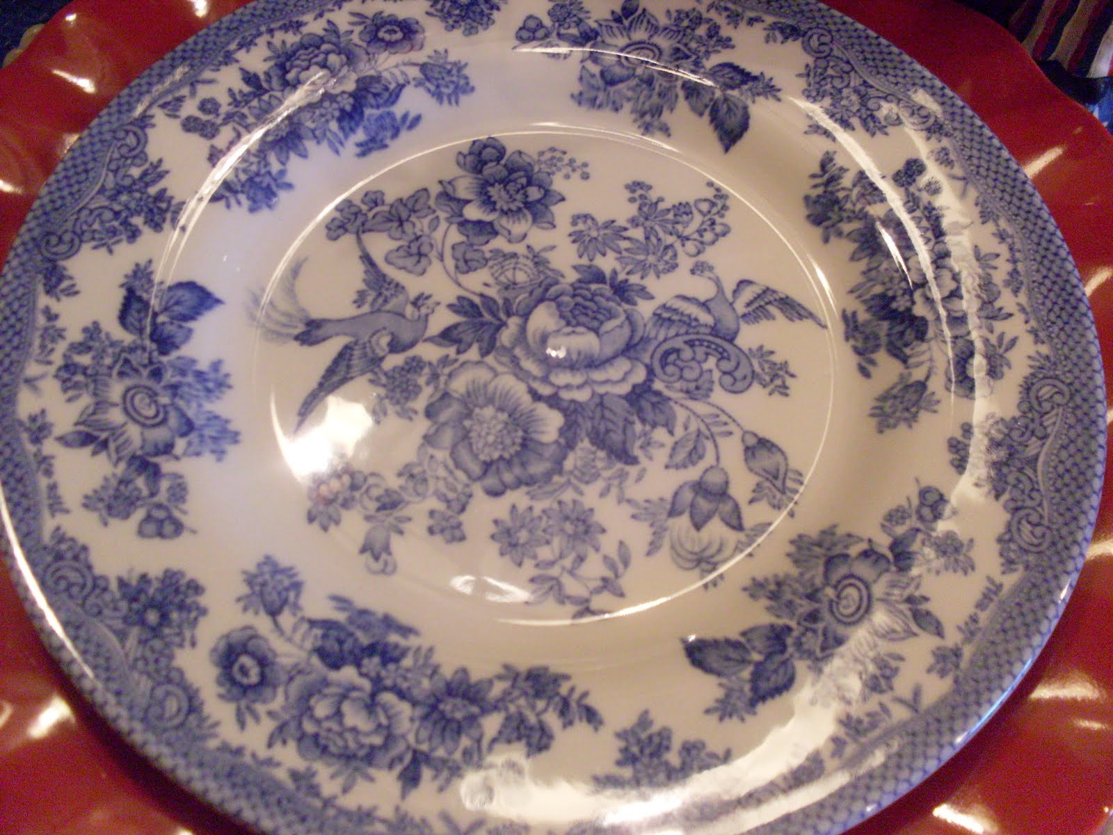 White ironstone dinner plates from JC Penney. Red scallop plates also from JC Penny. Blue and white Royal Stafford plates from TJ Maxx a few years ago. & FLOWERSHOPGURL: \
