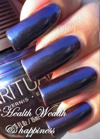 Black nail polish and lip gloss: Sparitual Health,Wealth & Happiness