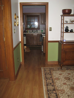 looking from the dining room to the kitchen.  Prior to the return of the dining room table