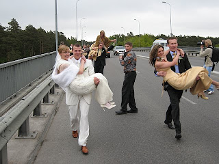 The Bridesmaids Loved Lithuanian Tradition That Groomsen Had To Carry Them Over Bridge Taking Example From A Groom Carrying Bride