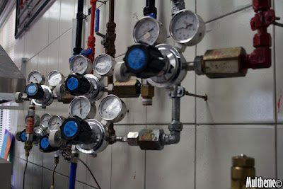 Lots of gauges and pipes and knobs