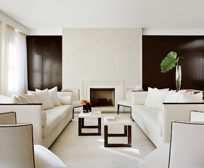 Contemporary-edgy-living-room-in-white-and-black-minimalistic-fireplace-small-tables