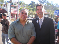 Steven Whitburn, County Board of Supervisor candidate, poses with fan