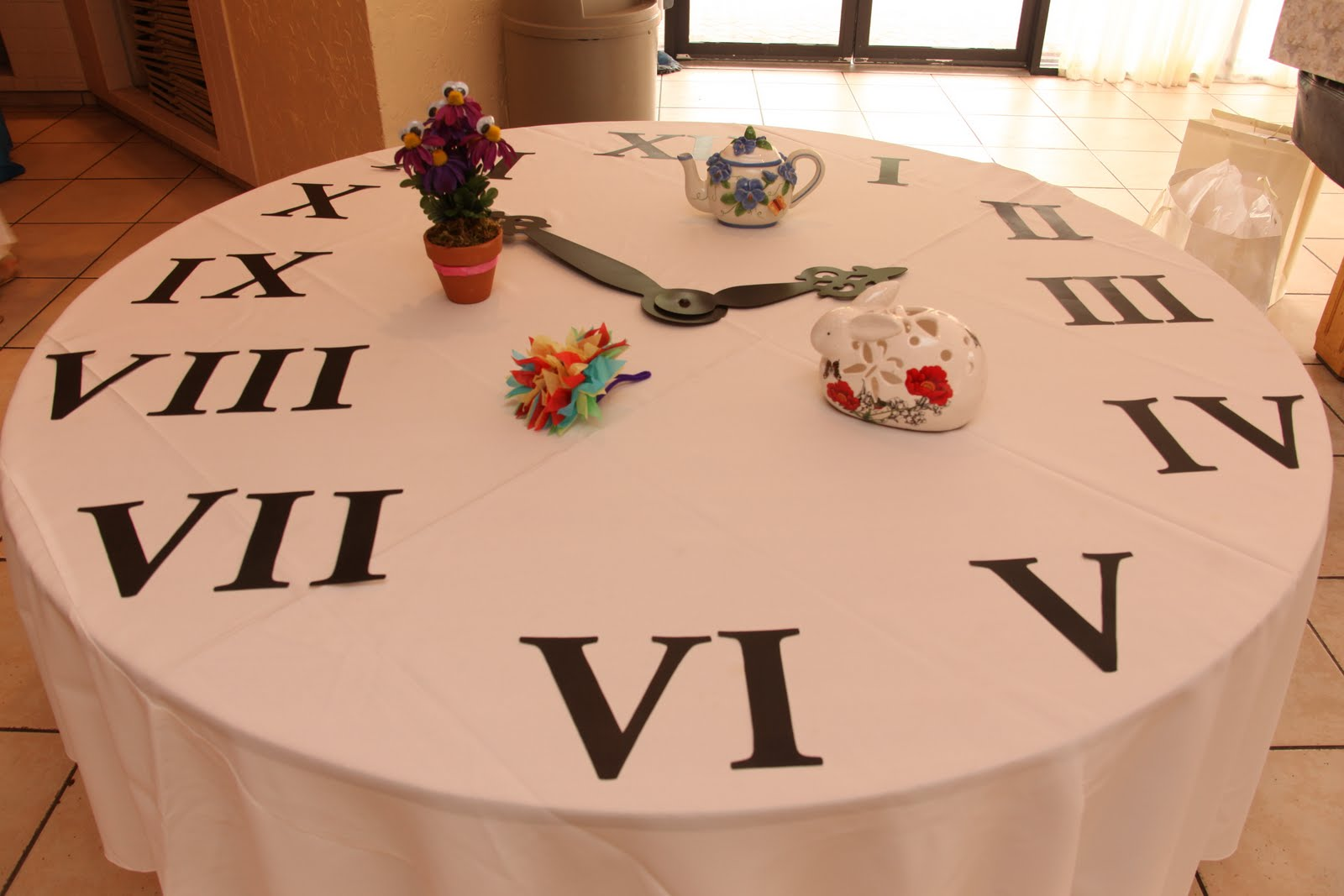 Mad hatter alice tea party on pinterest wonderland for Around the clock bridal shower decoration ideas