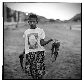 Sua, Ecuador - Brandon Allen Photography - Young boy and his fish