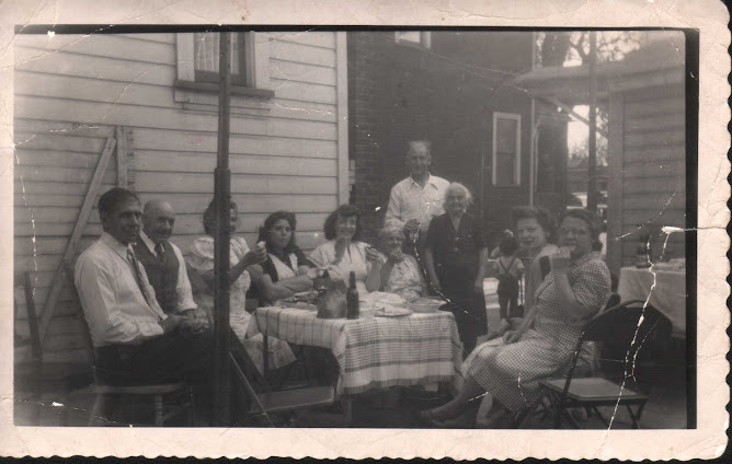 Dinning outdoors ~1940