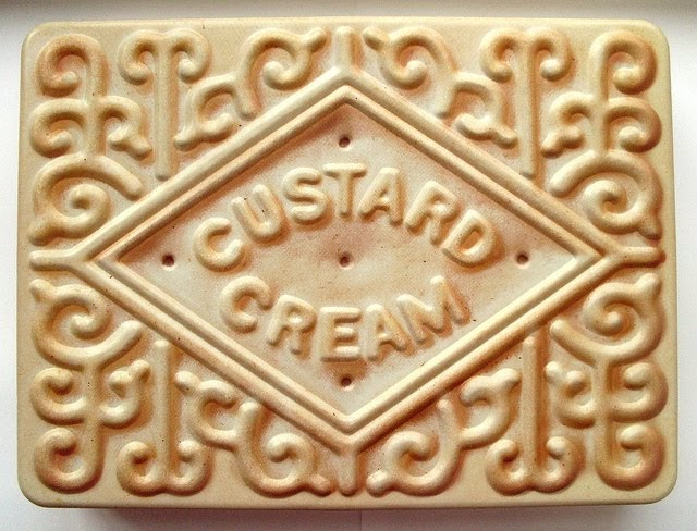 bugs and fishes by lupin  a giant custard cream