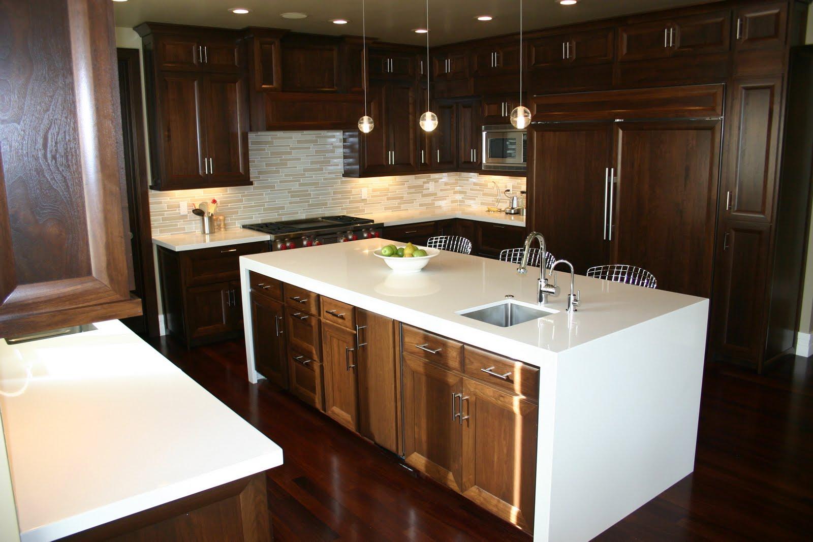 the granite gurus: walnut cabinets with stone countertops