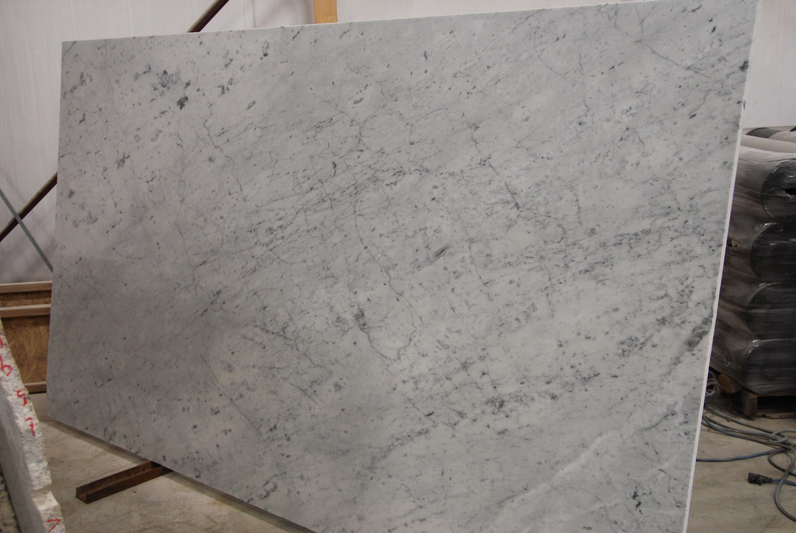 The Granite Gurus Slab Sunday Carrara Marble