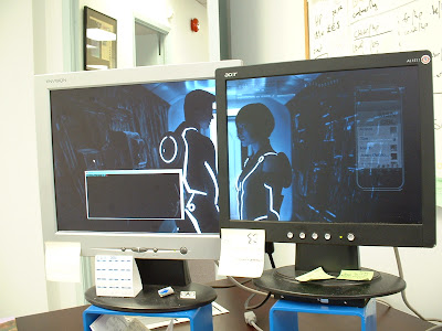 sam flynn quorra tron legacy dual monitor desktop wallpaper in action