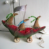 Northfieldprimitives makes these quirky toys on wheels.