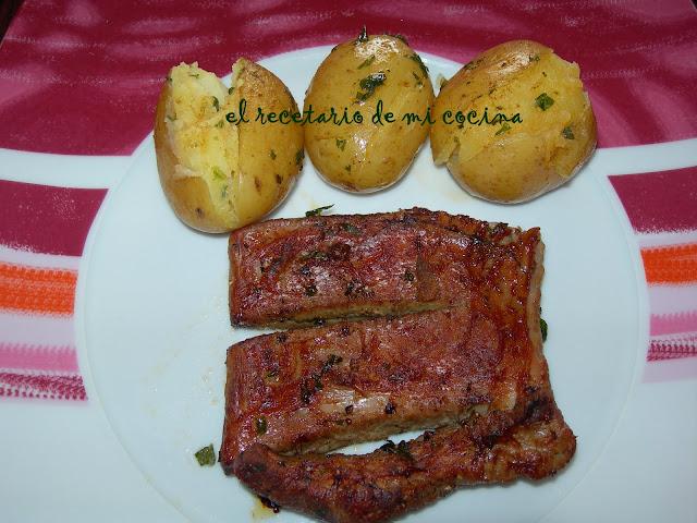 costilla asada con patatas al chimichurri