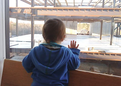 Mason watching construction