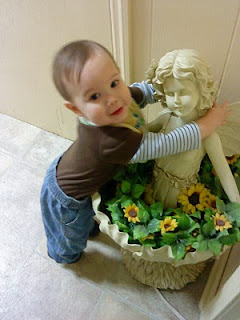 Mason hugging a fairy statue