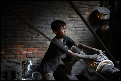 Child Polishing Utensils In A Factory