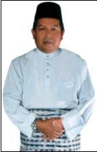 Timb. Pengerusi Badan Perhubungan UMNO Kelantan : YB Senator Dato' Dr. Awang Adek b. Hussin