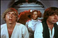 Screenshot from Hardware Wars in which the Wookie Monster attempts to eat the buns off of Princess Anne-Droid's head