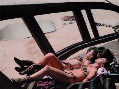 Bikini Leia and her stunt double nap in the Tatooine sunshine