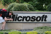 Photo of Tom next to Microsoft sign