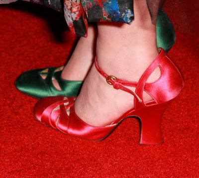 Helena Bonham Carter wearing one red and one green shoe