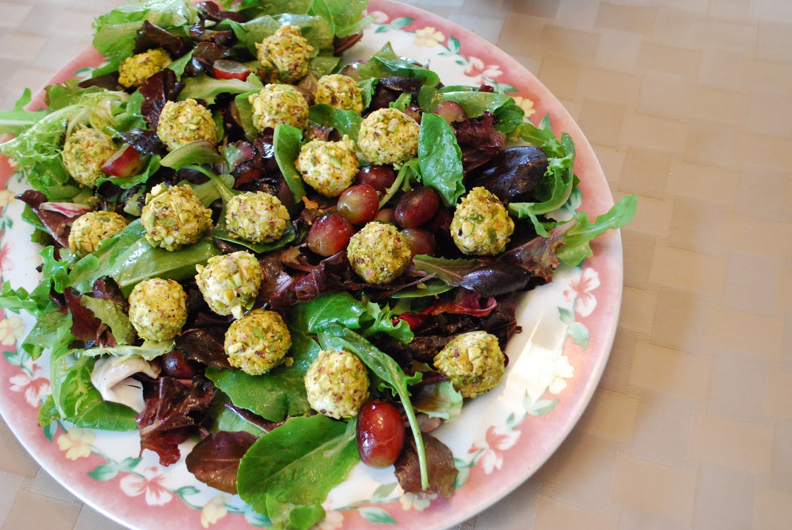 Spring salad with grapes and pistachio crusted goat cheese