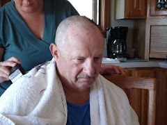 paul getting a buzz cut