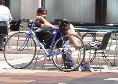 woman lounging with her blue bike