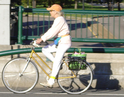 older lady on a bike
