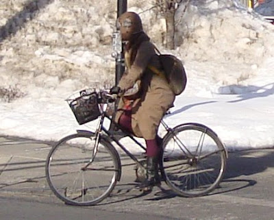 rolling on a bike in winter