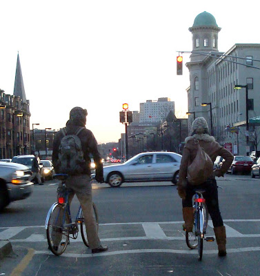 cold weather riders man woman bike date Boston