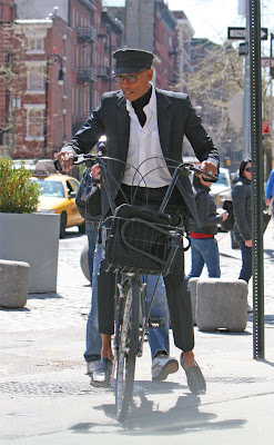RuPaul on a bike in Manhattan