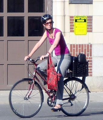 Lady cyclist bags rack