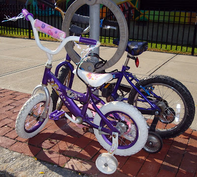 children's bikes locked in front of school