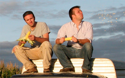 Ian Cheney and Curt Ellis, tasting their corn harvest. Photo by Sam Cullman